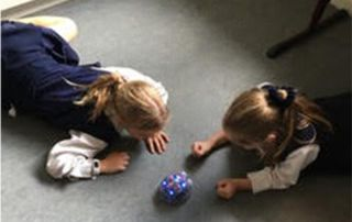 St Margaret Mary's Randwick North - students playing with robot
